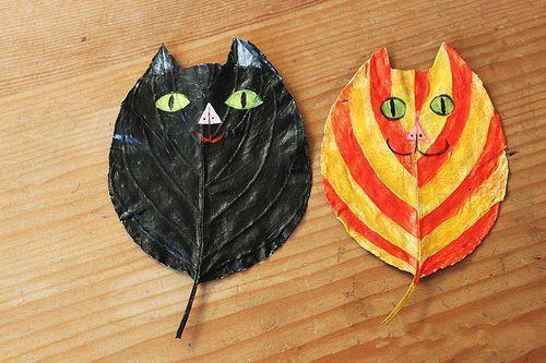 在树叶上描绘图案 利用树叶本身的形状,脉络来绘制图画,进行艺术创作